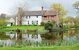 Brockhampton Estate - manor house across moat.jpg