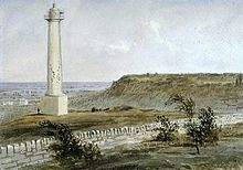 Painting with Brock's monument standing on the left side in a field, near a stone wall which runs diagonally along the bottom.
