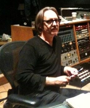 Vig sitting at a mixing console