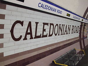 Caledonian Road tube station - The distinctive nameplate and tilework pattern