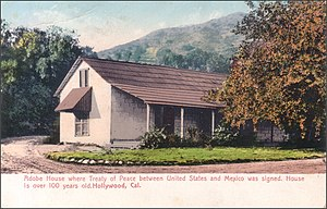 Campo de Cahuenga - Tinted postcard of the original adobe ranch house, with Cahuenga Peak in the background.