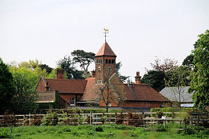Bulls Cross - Capel Manor stable block. The weather vane depicts a Clydesdale horse