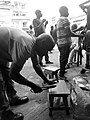 Carpenter fixing a chair.jpg