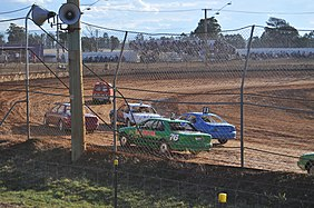 cars racing on a dirt track