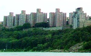 Castle Village - The five buildings of Castle Village as seen from the Hudson River in July 2005, showing the collapsed retaining wall under the fourth building from the left