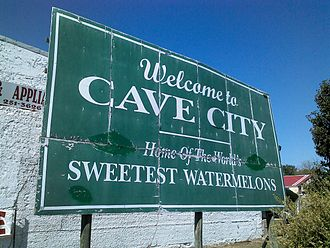 "Cave City, Arkansas - The Cave City welcome sign boasts that the town is the ""Home of the World's Sweetest Watermelon""."