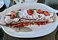 Chocolate cake with cream and strawberries.jpg