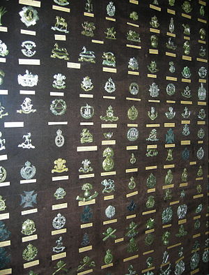 Cap badge - Cap badges at Cliffe Castle Museum, Keighley.  View at max resolution to read labels.