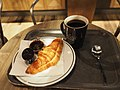 Coffee and croissant at Espresso House in Turku.jpg