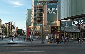 Wilshire/Western station - The subway plaza, with bus stop sign for the westbound Metro Rapid 720