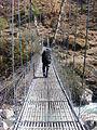 Crossing one of the last suspension bridges back to Syrabu Bese.jpg