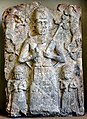 Cult wall relief from Assur. A deity, probably god Assur, is flanked by 2 water deities and 2 goats. 2000-1500 BCE. Pergamon Museum, Berlin.jpg