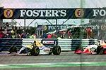 Damon Hill - Williams FW15C leads Michele Alboreto - Lola T93-30 into Copse during practice for the 1993 British Grand Prix (33645957396).jpg