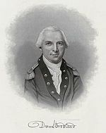 Black and white portrait shows a white-haired man in a dark military coat with darker lapels and a white shirt.