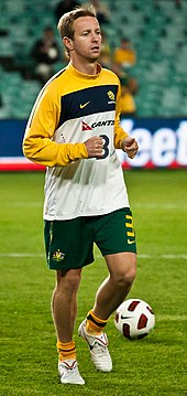 David Carney warming up before a game for Australia