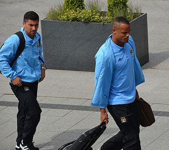 David Pizarro - Pizarro and Vincent Kompany arriving at a Manchester City match in May 2012