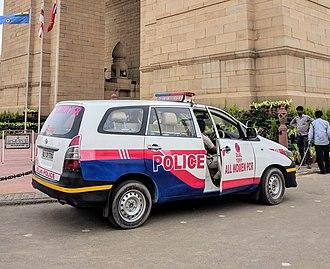 Delhi Police - A Delhi Police All Women PCR vehicle. The car pictured is a Toyota Innova.