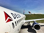 Delta 717 passing the new A321 (26109474513).jpg