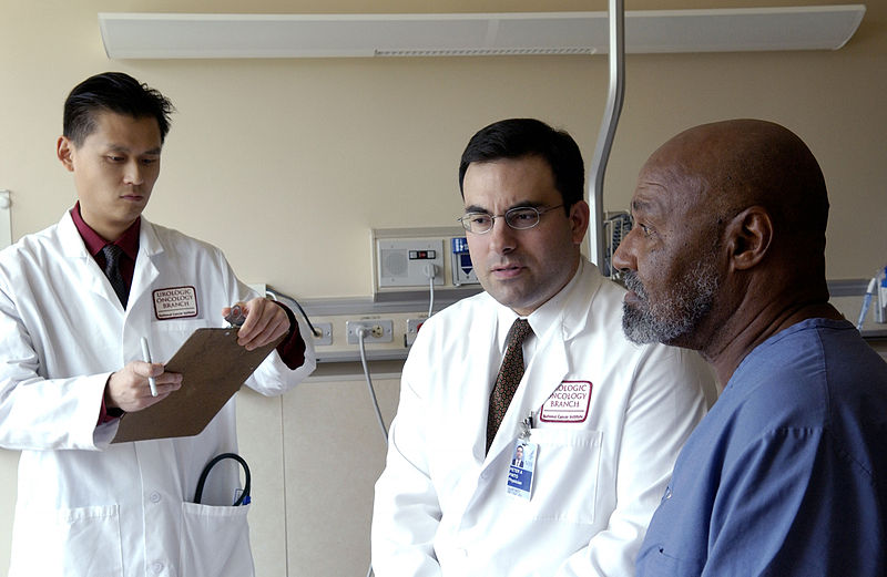 File:Doctor consults with patient (1).jpg