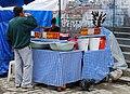 Drinking mocochinchi in market in La Paz.jpg