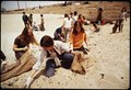 EIGHTH GRADE STUDENTS FROM ST. BONAVENTURE HIGH SCHOOL SPEND RECESS PERIOD PICKING UP TRASH ON BEACH - NARA - 542655.tif