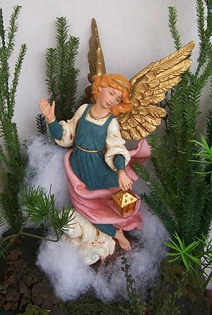 Angel appearing to shepherds for Nativity scen...