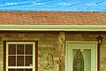 FEMA - 44325 - Blue tarp on a tornado damaged home in Oklahoma.jpg