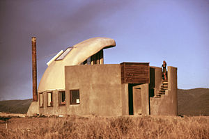"""Earthship - Michael Reynolds' first building, the """"Thumb House"""", was built in the early 1970s. It included features incorporated into later Earthship designs."""