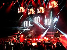 fall out boy performing at a concert during the monumentour - Fall Out Boy Christmas