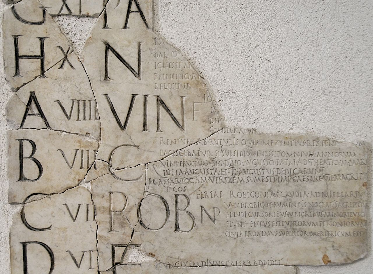 A fragment of a Roman calendar, showing the nundinal letters on the left edge