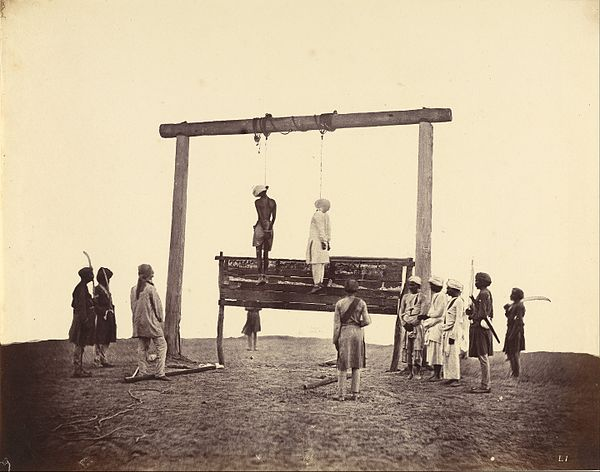 The hanging of two participants in the Indian Rebellion, Sepoys of the 31st Native Infantry. Albumen silver print by Felice Beato, 1857. Felice Beato (British, born Italy - Two Sepoys of the 31st Native Infantry, Who Were Hanged at Lucknow, 1857 - Google Art Project.jpg
