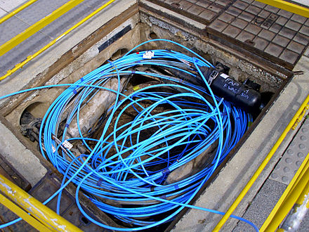 Multi-mode optical fiber in an underground service pit Fibre-optic cable in a Telstra pit.jpg