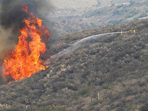 Santiago Fire - Firefighters battle the blaze