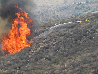 2007 California wildfires - Firefighters battle a blaze near Irvine, California.