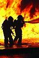 Firefighters extinguishing a jet fuel fire (2012).jpg