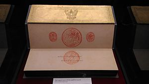 Constitution of Thailand - The initial pages of the 1952 constitution of Thailand, to which King Bhumibol Adulyadej affixed his signature and his regnal seal, accompanied by the three seals of the realm on the above.