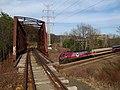 Fitchburg Line train passing under Central Mass bridge, April 2017.JPG