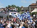 Flags wave as the wives and children pass - geograph.org.uk - 807245.jpg