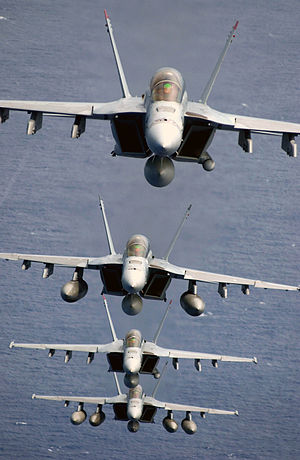 "Boeing F/A-18E/F Super Hornet - Four F/A-18Fs of VFA-41 ""Black Aces"" in a trail formation. Note the AN/ASQ-228 ATFLIR pods on the first and third aircraft, and a buddy store tank on the last aircraft"