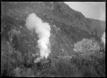 Freight train pulling out of Parera Station in the Taieri River valley. ATLIB 289985.png