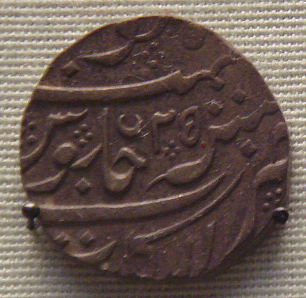 The French East India Company issued rupees in the name of Muhammad Shah (1719-1748) for Northern India trade. This was cast in Pondicherry. French issued rupee in the name of Mohammed Sha 1719 1758 for Northern India trade cast in Pondicherry.jpg