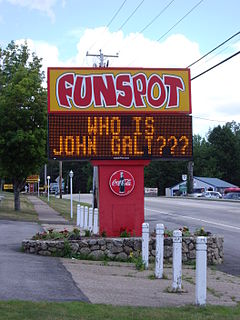 Funspot's road sign with text referring to 'Atlas Shrugged' by Ayn Rand