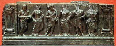 Greco-Buddhist frieze of Gandhara with devotees, holding plantain leaves, in Hellenistic style, inside Corinthian columns, 1st-2nd century CE. Buner, Swat, Pakistan. Victoria and Albert Museum.