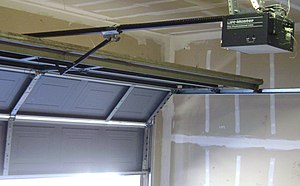 Photograph of a chain-drive garage door opener. This residential unit is manufactured by The Chamberlain Group, Inc. under the LiftMaster brand name..