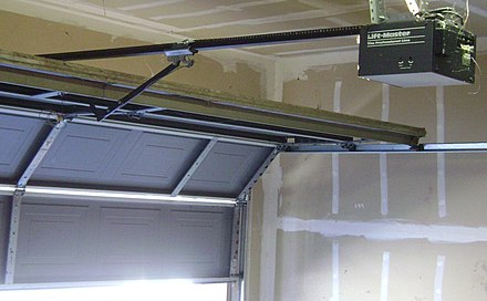 A residential garage door opener. The motor is in the box on the upper-right. Garage door opener.jpg