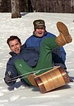 George H. W. Bush and Arnold Schwarzenegger sledding at Camp David.jpg