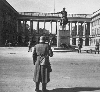 Biuro Szyfrów - German sentries before the Saxon Palace (Polish General Staff building) where the German military Enigma had been broken and read by the Poles for several years before the war.  Photo taken before 30 August 1940, when the Germans concealed Thorvaldsen's statue of Prince Józef Poniatowski.