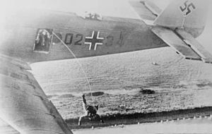 German paras jumping from Ju 52 1938.jpg