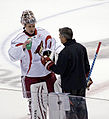 Goalie Ilya Bryzgalov also chats up Tipp (5007432154).jpg