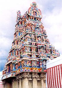 "A gopuram (tower) of the Meenakshi Amman Temple, a Shakta temple at Madurai, Tamil Nadu, India, which was nominated in the ""New Seven Wonders of the World"" competition in 2004."